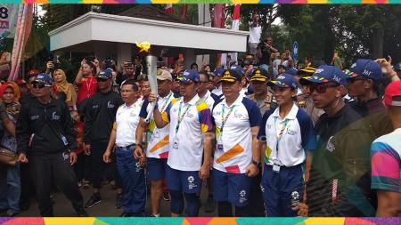 Usai Lalui Perjalanan Panjang, Kirab Obor Asian Games Tiba di Kota Bogor. - INDOSPORT