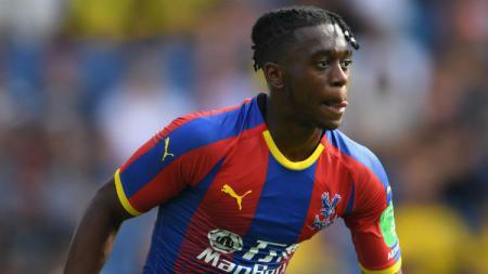 Aaron Wan-Bissaka, bek kanan Crystal Palace, bisa saja memecahkan rekor transfer Manchester United jika hengkang ke Old Trafford. - INDOSPORT
