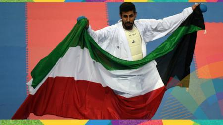 Atlet karate Kuwait, Rasheed al-Mutairi usai mengalahkan Jepang dalam Asian Games 2014. - INDOSPORT