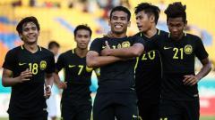 Indosport - Muhammad Safawi Rasid (tengah) pasca mencetak gol ke gawang Korea Selatan.