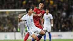 Indosport - Hanif Sjahbandi saat melawan Timnas Malaysia