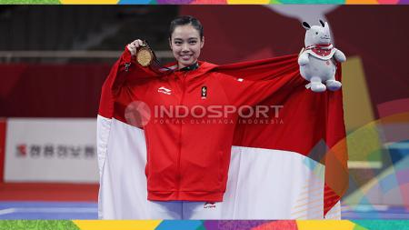 Atlet wushu Indonesia, Lindswell Kwok sabet medali emas Asian Games 2018. - INDOSPORT