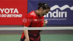 Indosport - Gregoria Mariska Tunjung, berhasil menang atas tunggal putri Jepang, Akane Yamaguchi.
