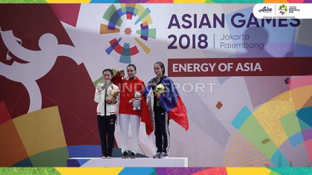 Lindswell Kwok meraih medali emas di Asian Games 2018. - INDOSPORT