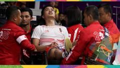 Indosport - Anthony Sinisuka Ginting langsung ditangani tim medis di Asian Games 2018.