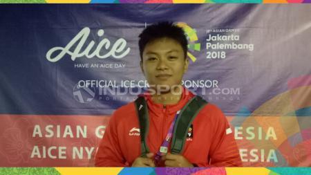 Dari empat medali emas SEA Games 2019 yang diraih kontingen angkat besi Indonesia, salah satunya dipersembahkan oleh Rahmat Erwin Abdullah. - INDOSPORT