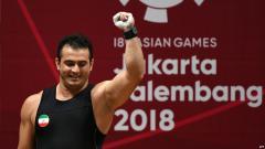 Indosport - Moradi, atlet angkat besi Iran.