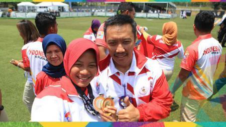 Diananda Choirunisa mendapat wejangan dari Imam Nahrawi jelang partai final Asian Games 2018. - INDOSPORT