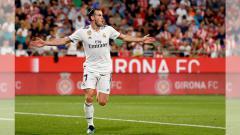 Indosport - Gareth Bale usai mencetak gol