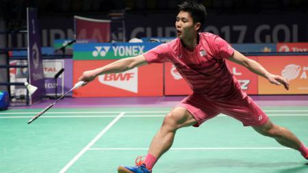 Pebulutangkis asal China Taipei, Chou Tien Chen, menunjukkan reaksi gila saat melakukan rally dengan wakil Jepang, Kento Momota, di final Fuzhou China Open 2019. - INDOSPORT