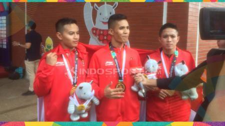 Nunu Nugraha, Anggi Faisal, dan Asep Yuldan, atlet pencak silat. - INDOSPORT