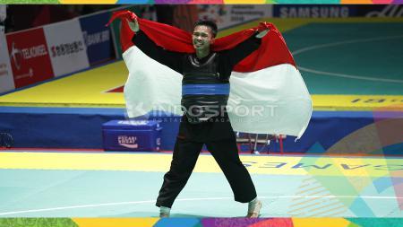 Selebrasi pesilat Indonesia, Abdul Malik usai memastikan juara dan medali emas. - INDOSPORT