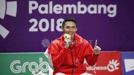 Tunggal putra Indonesia, Jonatan Christie, menyabet medali emas nomor perseorangan cabang olahraga bulutangkis Asian Games 2018. - INDOSPORT