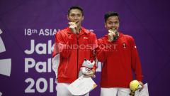 Indosport - Jonatan Christie dan Anthony Sinisuka Ginting di ajang Asian Games 2018.