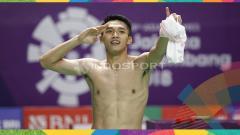 Indosport - Aksi selebrasi Jonatan Christie usai menang dan memastikan raih medali emas Asian Games 2018.