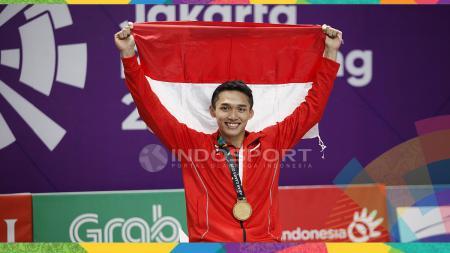 Tunggal putra Indonesia, Jonatan Christie, menyabet medali emas nomor perseorangan cabang olahraga bulu tangkis Asian Games 2018. Dalam partai final di Istora Senayan, Jakarta. - INDOSPORT