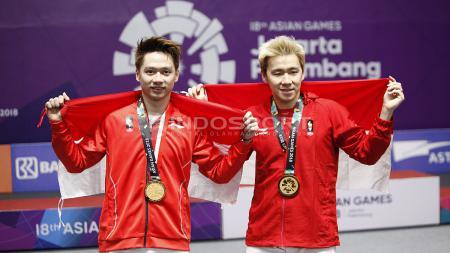 Kevin Sanjaya/Markus Fernaldi Gideon sabet medali emas cabor bulutangkis ganda putra Asian Games 2018. - INDOSPORT