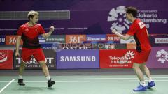 Indosport - Aksi selebrasi Kevin Sanjaya/Markus Fernaldi Gideon di Asian Games 2018.