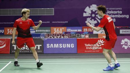 Aksi selebrasi Kevin Sanjaya/Markus Fernaldi Gideon di Asian Games 2018. - INDOSPORT