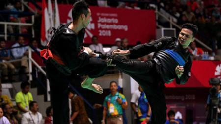 Atlet pencak silat Malaysia, Mohd Fauzi ketika melawan perwakilan Vietnam di final Asian Games 2018 - INDOSPORT
