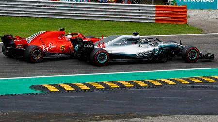 Ketika Hamilton menyalip Vettel di Formula 1 Italia 2018. - INDOSPORT