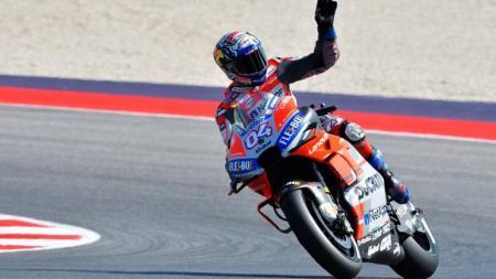 Andrea Dovizioso setelah memastikan juara di MotoGP San Marino 2018. - INDOSPORT