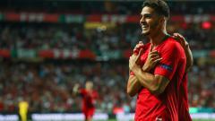 Indosport - Andre Silva berselebrasi usai mencetak gol ke gawang Italia dalam laga lanjuta UEFA Nations League.