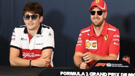 Charles Leclerc (kiri) dan Sebastian Vettel yang merupakan partner balapan di Ferrari untuk musim 2019. - INDOSPORT