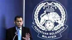 Indosport - Presiden Federasi Sepak Bola Malaysia (FAM), Hamidin Mohd Amin saat konferensi pers.