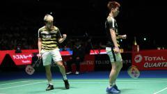 Indosport - Kevin Sanjaya/Marcus Gideon di Japan Open 2018.