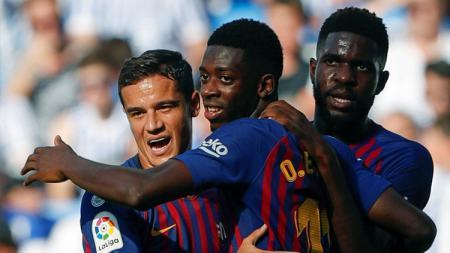 Ousmane Dembele turut menyumbangkan gol kemenangan Barcelona saat berjumpa Real Sociedad. - INDOSPORT