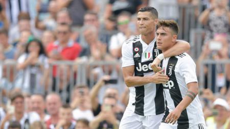 Cristiano Ronaldo dan Paulo Dybala, dua pemain bintang Juventus. - INDOSPORT