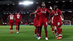Indosport - Daniel Sturridge berselebrasi usai mencetak gol.