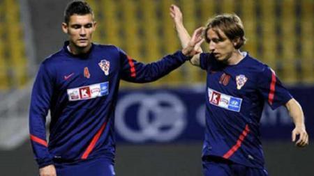 Dua penggawa andalan Timnas Kroasia, Luka Modric dan Dejan Lovren - INDOSPORT