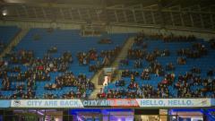 Indosport - Banyak kursi kosong saat laga Man City vs Lyon