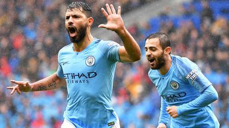 Sergio Aguero berselebasi usai mencetak gol saat melawan Cardiff City. - INDOSPORT