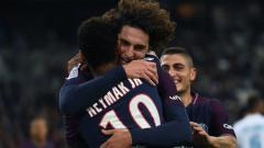 Indosport - Adrien Rabiot dan Neymar melakukan selebrasi di PSG