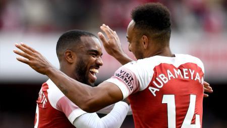 Aubameyang dan Lacazette menjadi dua pencetak gol Arsenal saat melawan Everton. - INDOSPORT