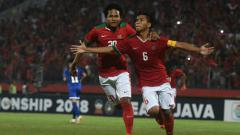 Indosport - Kapten Timnas U-16, David Maulana (kanan) Melakukan Selebrasi