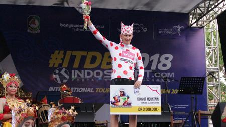 Marcus Culey menyabet jersey polkadot International Tour de Banyuwangi Ijen (ITdBI) 2018. - INDOSPORT