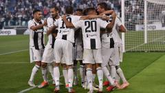 Indosport - Skuat Juventus merayakan gol.