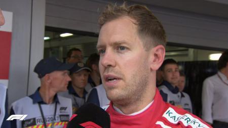 Sebastian Vettel hanya mampu menempati posisi ketiga di Formula 1 Rusia. - INDOSPORT