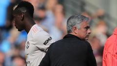 Indosport - Paul Pogba dan Jose Mourinho.