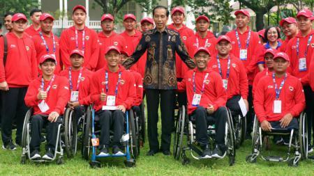 Presiden Joko Widodo melepas kontingen Indonesia di Asian Para Games 2018. - INDOSPORT
