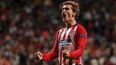 Indosport - Antoine Griezmann selebrasi usai cetak gol bersejarah Liga Champions di laga Atletico Madrid vs Club Brugge.