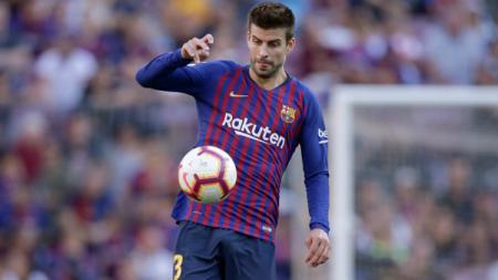 Gerard Pique, pemain Barcelona mengaku akan pulang ke rumah keduanya di Old Trafford, markas Man United. - INDOSPORT