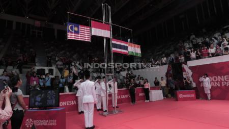 Perolehan Medali Emas, final beregu bulutangkis Indonesia vs Malaysia Asian Para Games 2018. - INDOSPORT