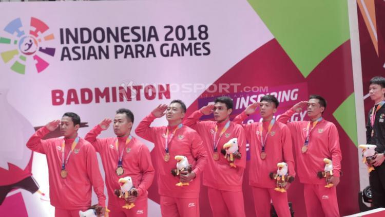 Perolehan Medali Emas, final beregu bulutangkis Indonesia vs Malaysia Asian Para Games 2018. Copyright: Roihan Susilo Utomo/Indosport.com