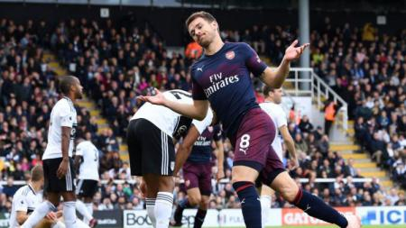 Ekspresi Aaron Ramsey usai mencetak gol di laga Fulham vs Arsenal, Minggu (07/10/18). - INDOSPORT