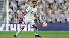 Indosport - Raphael Varane, bek tengah Real Madrid, yang diminati Manchester United.